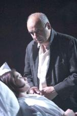 Phil Cavilleri at his dying daughter's bedside